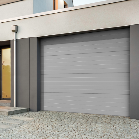 Comment isoler une porte de garage cap batiment - Pose porte de garage sectionnelle ...