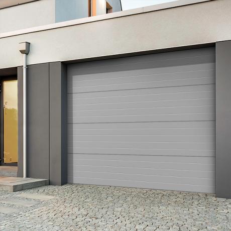 comment isoler une porte de garage cap batiment. Black Bedroom Furniture Sets. Home Design Ideas